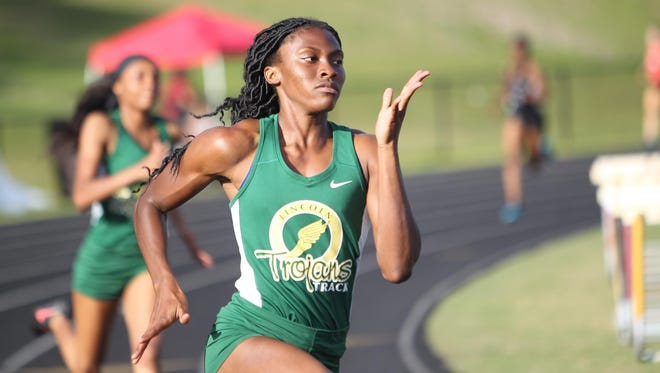 Lincoln's Tamani Wilson won district titles in the 200 and 400 on Saturday.