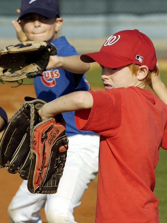 2 boys practice their pitching skills at Baseball Camp