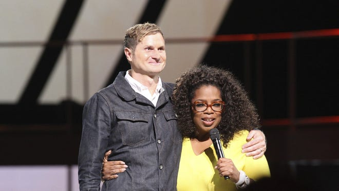 "Rev.  Rob Bell on stage with Oprah Winfrey during the Atlanta stop of ""Oprah's The Life You Want Weekend"" that comes to the Palace of Auburn Hills Friday through Saturday."
