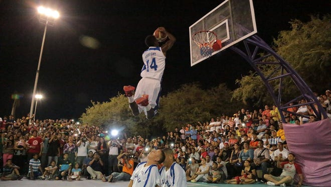 Former Skipper takes part in a dunk contest.