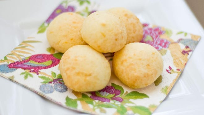 """Brazil: Steaming warm, fresh-from-the-oven pao de queijos, round-shaped """"cheese buns,"""" are a breakfast staple in Brazil. Fresh fruit or berries, such as the exotic acai, are also commonly enjoyed in the morning."""