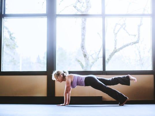 Mature Woman in Yoga Studio