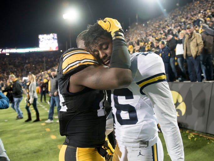 Michigan cornerback Jourdan Lewis is consoled by Iowa