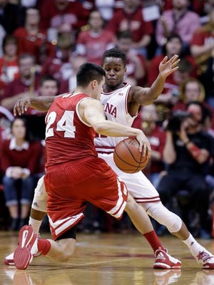 Wisconsin's Bronson Koenig (24) is defended by Indiana's Yogi Ferrell (11) during the second half of an NCAA college basketball game, Tuesday, Jan. 5, 2016, in Bloomington, Ind. Indiana won 59-58.