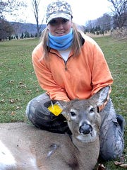 Billi Mouillesseaux, of Spencer, shows off a whitetail doe she harvested.