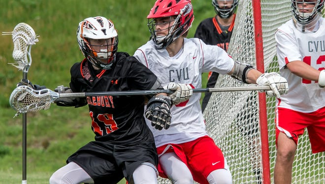 Middlebury's  Jackson Donahue works for position against CVU's Ryan Truss during their hard fought game in HInesburg on Friday. CVU won the overtime contest 7-6