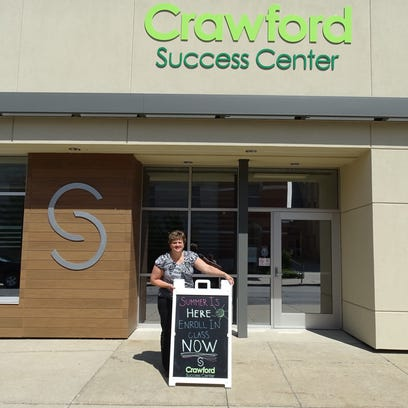 Dana Rausch of the Crawford Success Center places a
