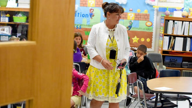 Principal Tammy Hipes observes briefly one of the classes at William Perry Elementary in Waynesboro on Tuesday, August 25, 2015.