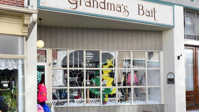"The front windows of Grandma's Bait welcomes passersby to ""Magical Main Street.""  The business placed second in the holiday window display judging with all entries following this year's theme of ""Magical Main Street."""