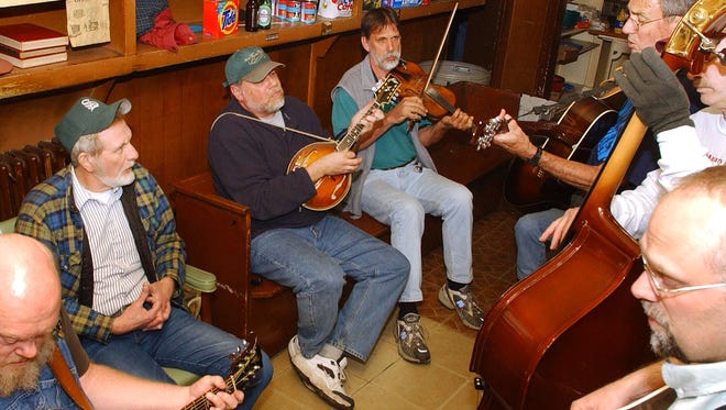 A photo from 2003 shows musicians gathering on a typical Tuesday night at Marino's Lunch in Staunton to play bluegrass.