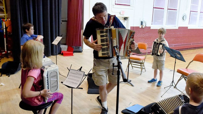Orville Bame teaches camp participants who learn to play the accordion in a class for beginners as part of the Grace Christian School Fine Arts Summer Camp in Staunton on Wednesday, June 7, 2017. During the school year, Bame is a music and history teacher with the school.