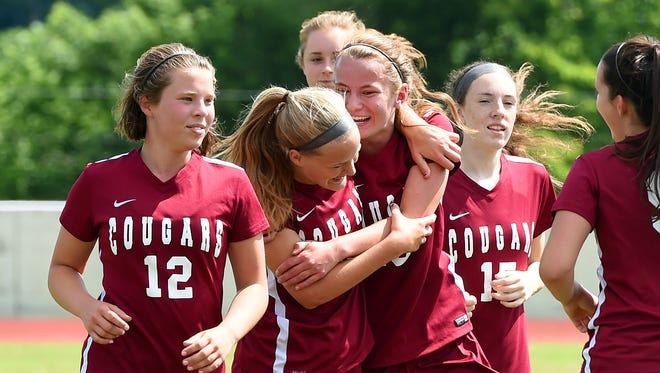 Stuarts Draft players celebrate as they come off the field after defeating Richlands to win a Group 2A state semifinal game in Radford on Friday, June 9, 2017. Stuarts Draft defeated Richlands 4-1 and will advance to the state Group 2A championship on Saturday.