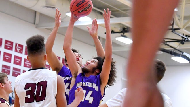 Stuarts Draft's Damien Fisher comes away with the rebound during a game played in Stuarts Draft on Wednesday, Dec. 13, 2017. Waynesboro defeated Stuarts Draft, 93-87.