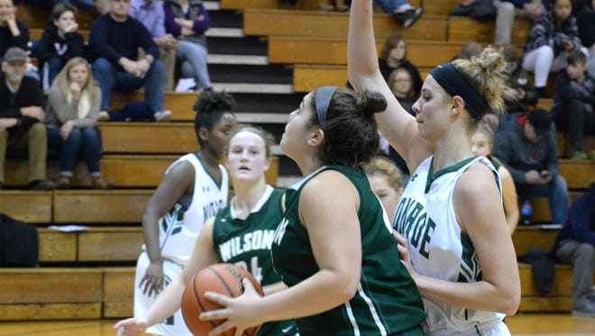 Wilson's Sarah Sondrol looks to score Saturday in her team's loss to William Monroe.