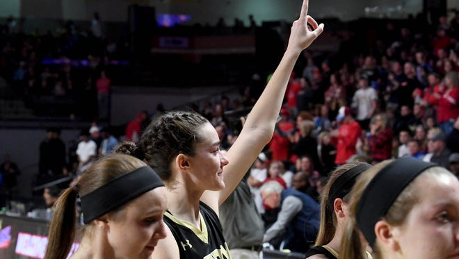 Buffalo Gap's Leah Calhoun signals to their fans with a smile despite their loss to Central-Wise in the VHSL Class 2 girls state championship game played in Richmond on Friday, March 9, 2018.