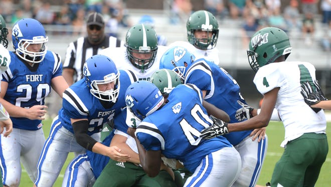 Fort Defiance's defense swarms on a William Monroe ball carrier Saturday during Fort's 14-7 win.