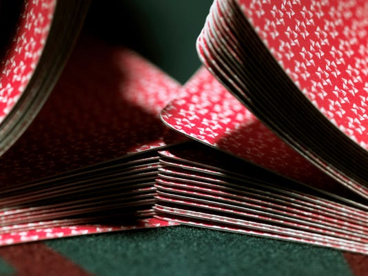 Cards being shuffled on gaming table, close-up