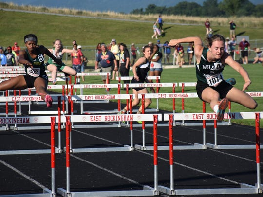 Wilson Memorial's Emilie Miller, right, competes in a qualifying heat for the  Group 2A girls 100-meter hurdles at the VHSL Group 1A/2A track and field championships on Friday, June 2, 2017, at East Rockingham High School in Elkton, Va. Miller set a Group 2A meet record with a time of 14.43 seconds.