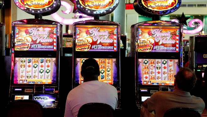 In this May 24, 2012 file photo, patrons play the slot machines.