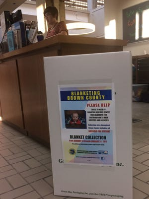 A collection box for the sixth annual Blanketing Brown County drive at the entrance of the Brown County Central Library in downtown Green Bay on Thursday.