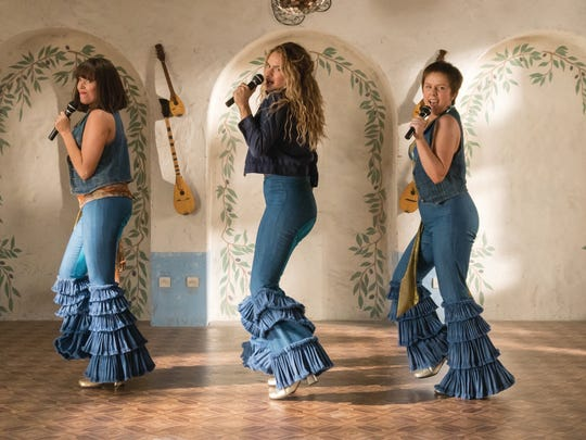 "Young Tanya (Jessica Keenan Wynn, from left),  young Donna (Lily James) and young Rosie (Alexa Davies) share their inner ABBA in ""Mamma Mia! Here We Go Again."""