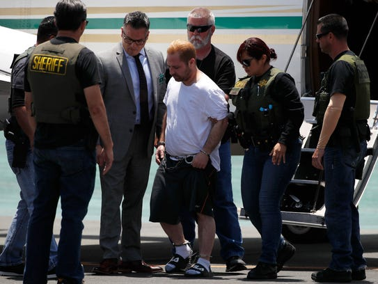 Aramazd Andressian Sr., center, a suspect in killing