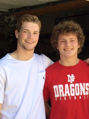Zionsville's Nolan Elsbury and New Palestine's Logan Greene will square off in Friday's Class 5A regional. They are cousins.