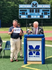 Dr. Jack Kripsak (left) participated in a press conference at Metuchen High School on Wednesday regarding minimizing the risk of heat stroke for student-athletes.