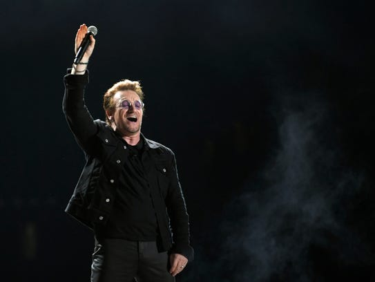 U2's Bono performs on the What Stage during the headliner