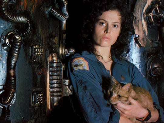 "With a people-eating ""Alien"" being stalking a spaceship both woman (Sigourney Weaver) and cat have to be careful not to become lunch."