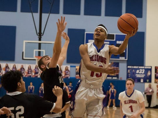 Buldawg Rayshawd Brown puts up a left handed layup during boys prep basketball on Tuesday against Hobbs.