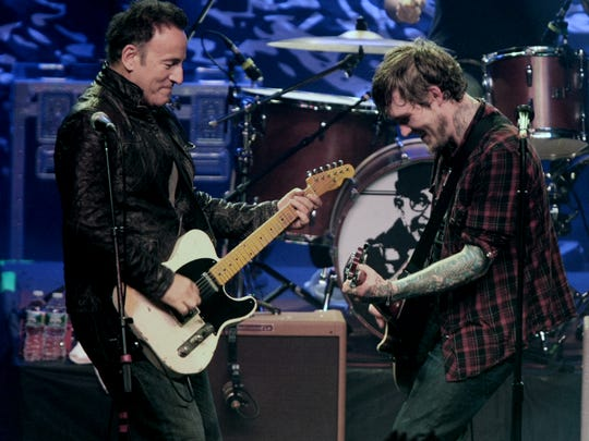 "Rock and Roll legend Bruce Springsteen (left) joins lead singer Brian Fallon (right) of the band The Gaslight Anthem for their song "" American Slang"" on stage at Convention Hall in Asbury Park, New Jersey on Friday Dec. 9, 2011.  The Gaslight Anthem performed a sold out show for the benefit for the Wounded Warrior Project.   ASBURY PARK ON FRI DEC. 9,2011 MARK R. SULLIVAN/STAFF PHOTOGRAPHER"