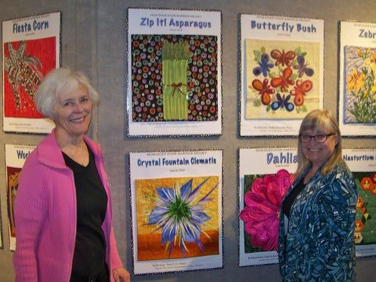 "Linea Egbert and Geri Dee in front of ""Seeds for SAQA"" exhibit."