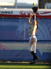 Abilene High left fielder Aubrianna Salazar (12) pulls in a fly ball at the fence during the bottom of the third inning of the Lady Eagles' 13-1 win in the Abilene Icebreaker softball tournament on Friday, Feb. 24, 2017, at Cooper High School.