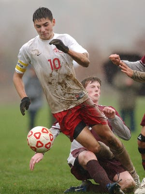Red Hook High School's Kyle Murphy, left, and New Paltz High School 's Andrew Barry compete for the ball during the boys' soccer game on October, 28, 2009.
