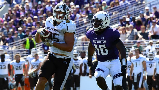 Western Michigan Broncos tight end Donnie Ernsberger (85) makes a catch against Northwestern Wildcats safety Godwin Igwebuike (16) during the fourth quarter at Ryan Field. Western Michigan defeated Northwestern 22-21.