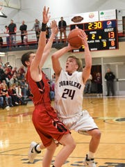 John Glenn's Justin Heacock shoots the ball against New Philadelphia in Saturday's district finals. Heacock is one of several players who also led the football team to the final four.