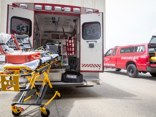 A Delaware County EMS ambulance and squad vehicle sit outside the downtown EMS station with just a small portion of the gear they keep stocked to treat a wide array of injuries they can be called out to.