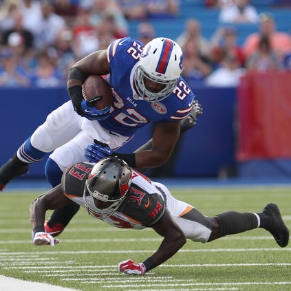 Tampa Bay Buccaneers defensive back Deveron Carr (33) tackles Buffalo Bills running back Fred Jackson (22) during the second half at Ralph Wilson Stadium. Tampa Bay beats Buffalo 27 to 14.