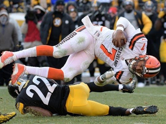 Cleveland Browns quarterback DeShone Kizer (7) is upended by Pittsburgh Steelers free safety William Gay (22) at the end of a run during the second half of an NFL football game in Pittsburgh, Sunday, Dec. 31, 2017. (AP Photo/Don Wright)