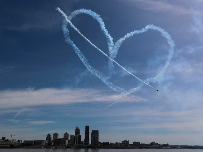 A pilot completes a heart over Louisville and the Ohio