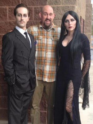 """Jared Davis, left, plays Gomez and Paige Allred, right, plays Morticia in The Stage Door's production of """"The Addams Family."""" Josh Scott, center, is directing."""