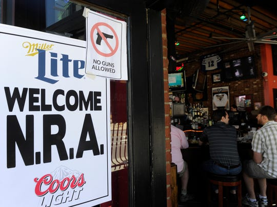 Several bars along Broadway posted signs welcoming NRA members and some bars also posted no guns allowed.