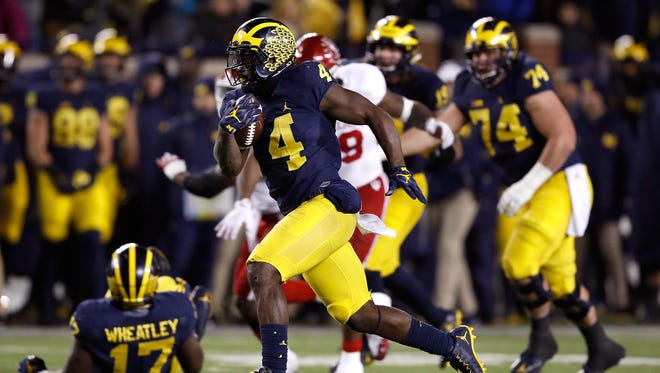De'Veon Smith runs for one of his two TDs Saturday. Smith was quiet after scoring as his teammates cut loose.