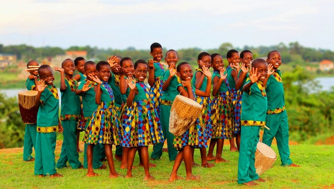 The African Children's Choir smiles for the camera.