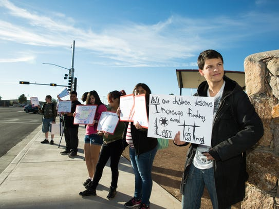 Las Cruces High School student Elijah Burton, 16, right,