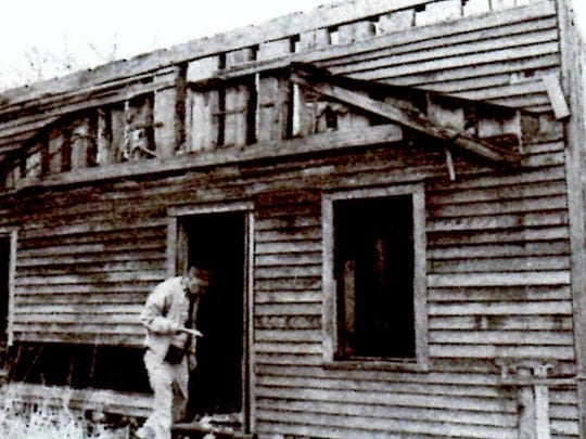 In 1981, Bill Morgan discovered this highly unusual vernacular architecture in St. Stephen. Its underlying construction is vertical logs, as shown in the top of the structure.