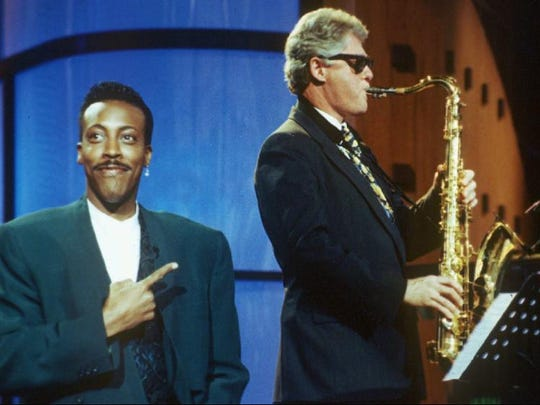 """Bill Clinton plays """"Heartbreak Hotel"""" as Arsenio Hall gestures approvingly on """"The Arsenio Hall Show"""" this June 3, 1992, file photo."""