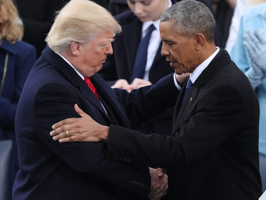 President Trump is embraced by former president Barack Obama  after taking the oath of office as the 45th President of the United States in Washington, D.C., Jan. 20, 2017.