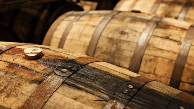 Beer is stored in bourbon barrels at Against The Grain Brewery at Louisville Slugger Field on Main Street. The brewery will provide a barrel-aged brew for Tailspin's Barrel Roll event Friday.